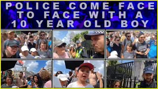 Police Come Face To Face With A 10 Year Old Boy With A Brain At London Protest